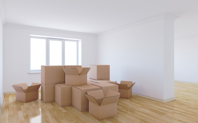 3d render of moving boxes in empty room